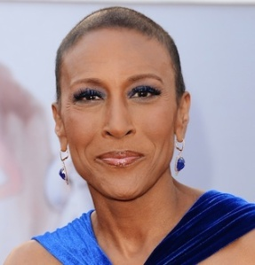 Robin Roberts comes out as a lesbian.